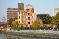 Atomic Bomb Dome on the rivershore of Ota river. Hiroshima. Japan