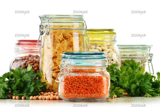 Jars with grain foods isolated on white background