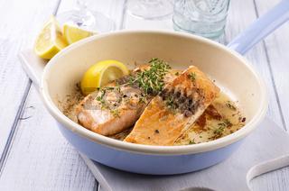 salmon fillet fried in a pan