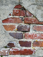 Old dilapidated wall made of brick
