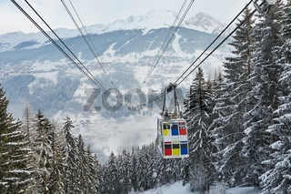 Skiing lift cabin over a valley