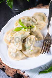 Polish pierogi filled with ramsons pesto