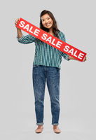happy smiling young asian woman with sale banner