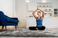 White caucasian woman do sit yoga at home