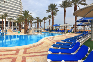 The picturesque pool and a  high-rise hotel