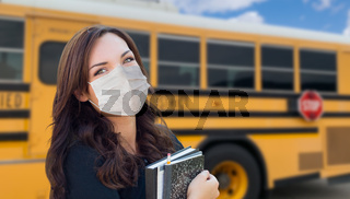 Female Student Near School Bus Wearing Medical Face Masks During Coronavirus Pandemic