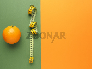 Diet or healthy eating concept with an orange fruit