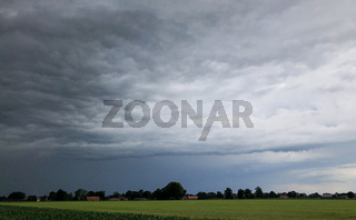 The coming of a big storm, tempest or hurricane over the countryside landscape.
