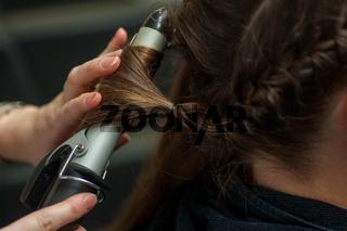 Hairdresser doing a woman's hair
