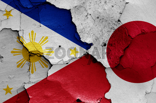flags of Philippines and Japan painted on cracked wall