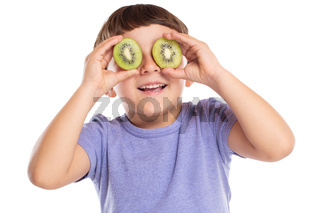 Little boy child with kiwi fruit having fun happy happiness healthy eating isolated on white