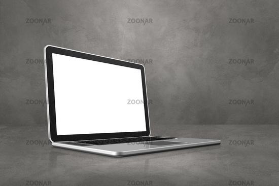 Laptop computer on concrete office scene background