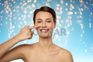 beautiful smiling woman showing her nose