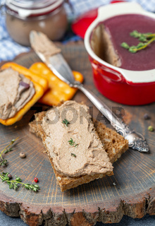 Slice of bread with chicken liver pate with thyme.