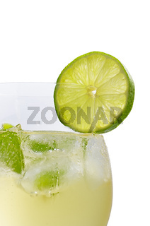 Drink with lime and mint in a wine glass