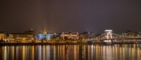 Night lighting view to the historical part and Chain bridge across the river in Budapest, Hungary