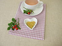 A cup of kernels tea from rose hip seeds
