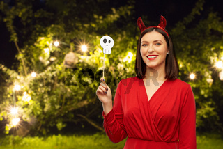 happy woman in red halloween costume of devil