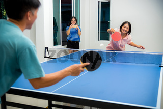 Couple fun playing table tennis indoor together