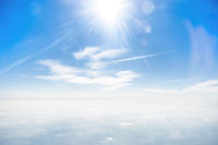 Sun on clear blue sky and clouds