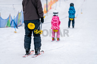 People on a small ski lift