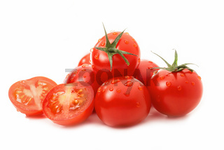Fresh tomatoes - one sliced - isolated against white