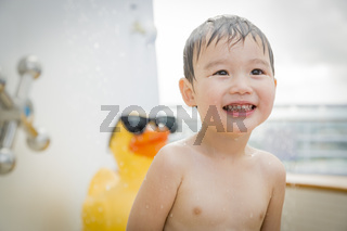 Mixed Race Boy Having Fun at the Water Park