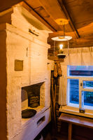 Rustic stove in the countryside - the interior of a wooden house