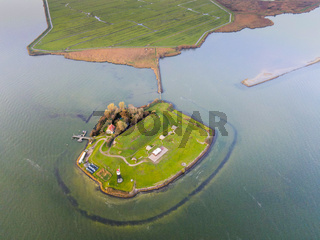 Top down aerial drone view of Vuurtoreneiland in Amsterdam, The Netherlands a small island