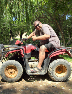 fun overweight man on quad bike
