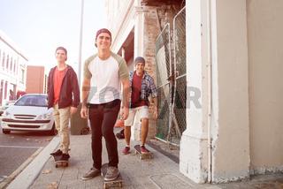 Guys skateboarders in street