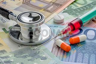 Stethoscope and syringe on bills