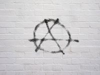 Circle A anarchy symbol on a wall
