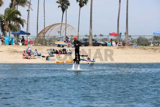 Man flying flyboarding on a Flyboard - hydroflighting