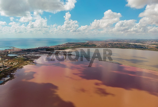 Beautiful aerial photo of Salt Lake of Torrevieja during sunny day clouds reflected in salted water. Alicante province, Spain