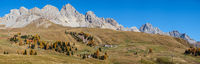 Autumn alpine mountain lake near San Pellegrino Pass, Trentino, Dolomites Alps, Italy.