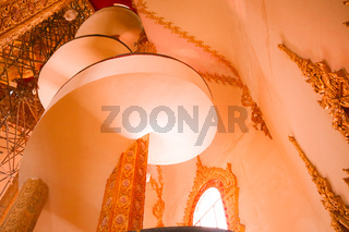 spiral staircase in a Buddhist temple in Bangkok, Thailand