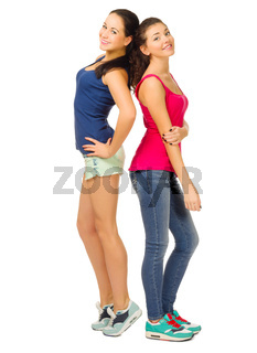 Two smiling sporty girls isolated