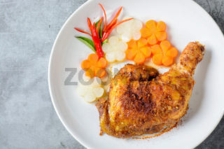 Hot and spicy baked chicken on white plate