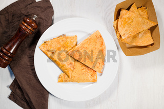 Mexican quesadilla on white plate.