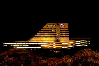 Night time view of UNISA main building with lights on