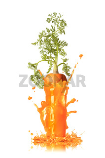 Carrot juice splash with root in the glass.