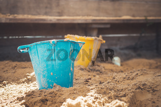 Childhood sandbox concept: Close up of plastic toy bucket
