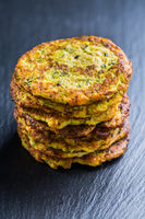 Zucchini pancakes on black background