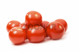 Ripe tomatoes isolated against white background