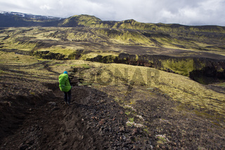 Woman traveler hiking the Laugavegur trail in Iceland, Europe.