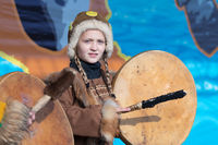 Girl dancing with tambourine in tradition clothing aborigine people Kamchatka Peninsula. Celebration