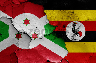 flags of Burundi and Uganda painted on cracked wall