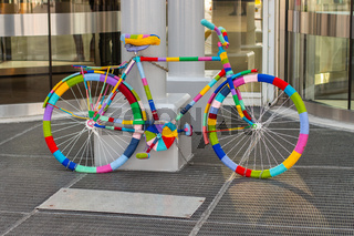 Rainbow bike decorated with colored threads, transport decorated in the hippie boho style