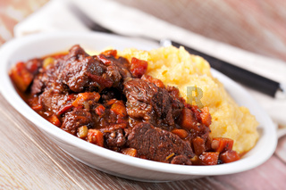 Delicious beef stew with mushrooms and polenta. High quality photo